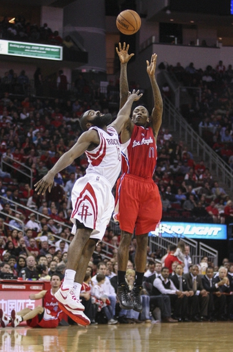 Nov 9, 2013; Houston, TX, USA; Los Angeles Clippers shooting guard Jamal Crawford (11) shoots during the fourth quarter as Houston Rockets shooting guard James Harden (13) defends at Toyota Center. The Clippers defeated the Rockets 107-94. Mandatory Credit: Troy Taormina-USA TODAY Sports