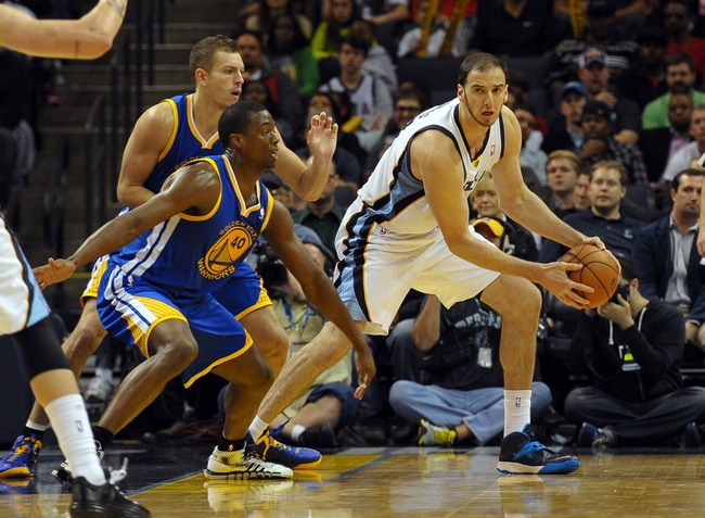 Nov 9, 2013; Memphis, TN, USA; Memphis Grizzlies center Kosta Koufos (41) handles the ball against Golden State Warriors small forward Harrison Barnes (40) during the fourth quarter at FedExForum. The Grizzlies won 108-90.  Mandatory Credit: Justin Ford-USA TODAY Sports