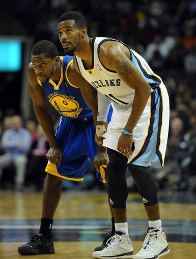 Nov 9, 2013; Memphis, TN, USA; Memphis Grizzlies point guard Mike Conley (11) and Golden State Warriors point guard Toney Douglas (0) talk during the fourth quarter at FedExForum. The Grizzlies won 108-90.  Mandatory Credit: Justin Ford-USA TODAY Sports