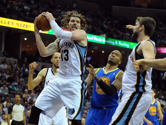Nov 9, 2013; Memphis, TN, USA; Memphis Grizzlies small forward Mike Miller (13) fights for a rebound against Golden State Warriors during the fourth quarter at FedExForum. The Grizzlies won 108-90.  Mandatory Credit: Justin Ford-USA TODAY Sports