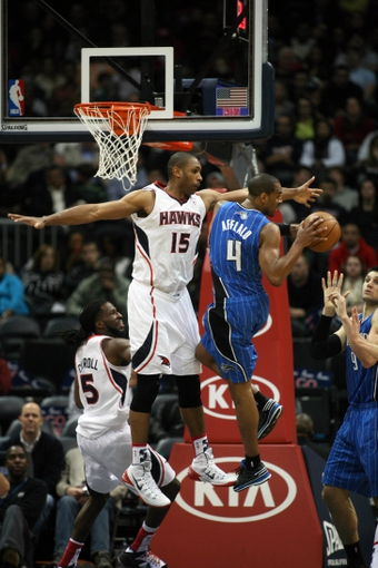 Nov 9, 2013; Atlanta, GA, USA; Atlanta Hawks center Al Horford (15) defends Orlando Magic shooting guard Arron Afflalo (4) in the fourth quarter at Philips Arena. The Hawks defated the Magic 104-94. Mandatory Credit: Brett Davis-USA TODAY Sports