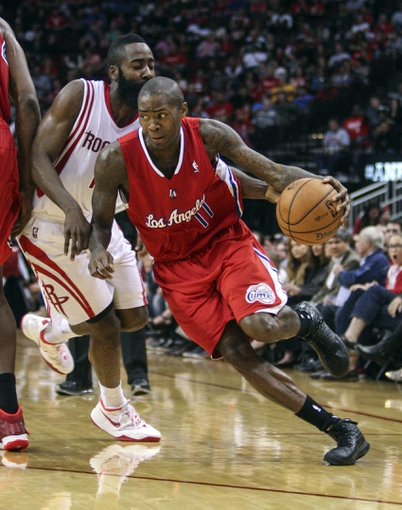 Nov 9, 2013; Houston, TX, USA; Los Angeles Clippers shooting guard Jamal Crawford (11) drives the ball past Houston Rockets shooting guard James Harden (13) during the third quarter at Toyota Center. The Clippers defeated the Rockets 107-94. Mandatory Credit: Troy Taormina-USA TODAY Sports