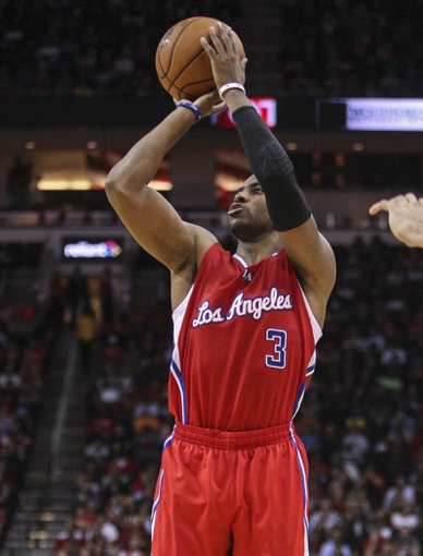 Nov 9, 2013; Houston, TX, USA; Los Angeles Clippers point guard Chris Paul (3) shoots during the fourth quarter against the Houston Rockets at Toyota Center. The Clippers defeated the Rockets 107-94. Mandatory Credit: Troy Taormina-USA TODAY Sports