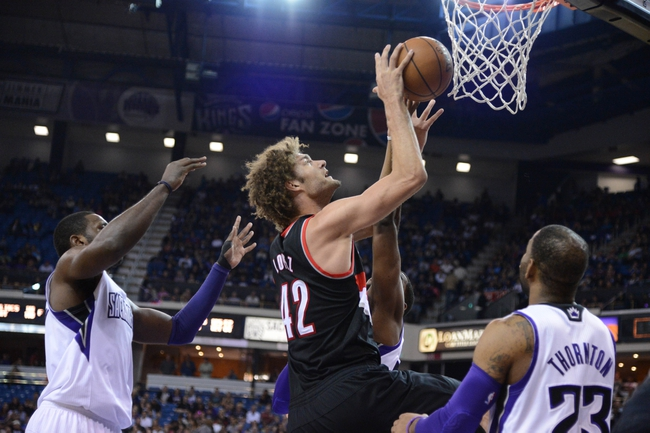 November 9, 2013; Sacramento, CA, USA; Portland Trail Blazers center Robin Lopez (42) shoots the basketball against Sacramento Kings power forward Patrick Patterson (9, left), power forward Jason Thompson (34, second from right), and shooting guard Marcus Thornton (23) during the second quarter at Sleep Train Arena. Mandatory Credit: Kyle Terada-USA TODAY Sports