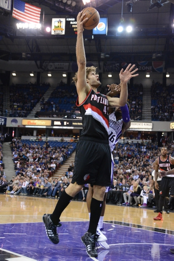 November 9, 2013; Sacramento, CA, USA; Portland Trail Blazers center Robin Lopez (42) shoots the basketball against Sacramento Kings shooting guard Ben McLemore (16) during the second quarter at Sleep Train Arena. Mandatory Credit: Kyle Terada-USA TODAY Sports