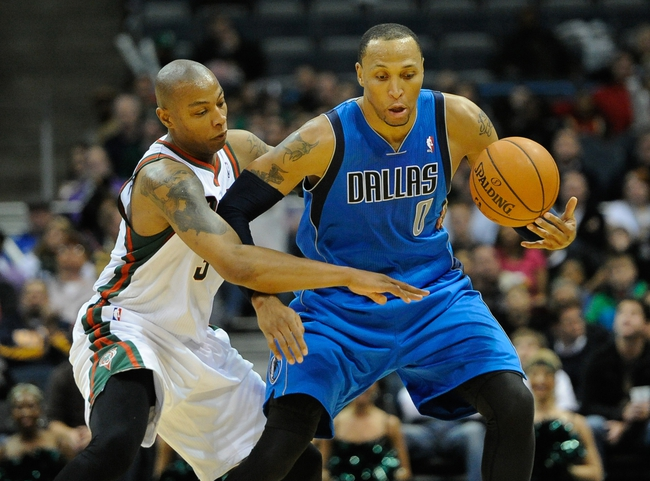 Nov 9, 2013; Milwaukee, WI, USA;  Milwaukee Bucks forward Caron Butler (3) tries to steal the ball from Dallas Mavericks forward Shawn Marion (0) in the 4th quarter at BMO Harris Bradley Center. The Mavericks beat the Bucks 91-83. Mandatory Credit: Benny Sieu-USA TODAY Sports