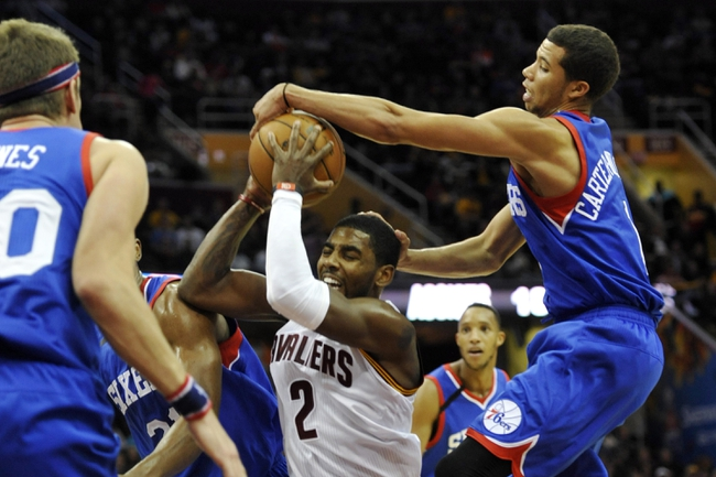 Nov 9, 2013; Cleveland, OH, USA; Cleveland Cavaliers point guard Kyrie Irving (2) drives the lane against Philadelphia 76ers point guard Michael Carter-Williams (1) in the third quarter at Quicken Loans Arena. Mandatory Credit: David Richard-USA TODAY Sports
