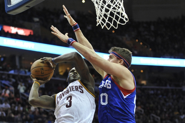 Nov 9, 2013; Cleveland, OH, USA; Cleveland Cavaliers shooting guard Dion Waiters (3) drives to the basket against Philadelphia 76ers center Spencer Hawes (00) in the fourth quarter at Quicken Loans Arena. Mandatory Credit: David Richard-USA TODAY Sports