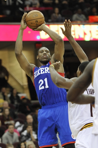 Nov 9, 2013; Cleveland, OH, USA; Philadelphia 76ers power forward Thaddeus Young (21) shoots in double overtime against the Cleveland Cavaliers at Quicken Loans Arena. Mandatory Credit: David Richard-USA TODAY Sports