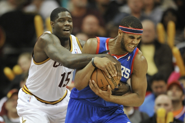 Nov 9, 2013; Cleveland, OH, USA; Philadelphia 76ers power forward Brandon Davies (right) is fouled by Cleveland Cavaliers small forward Anthony Bennett (15) in the third quarter at Quicken Loans Arena. Mandatory Credit: David Richard-USA TODAY Sports