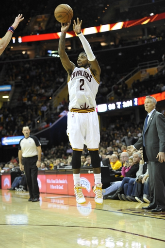 Nov 9, 2013; Cleveland, OH, USA; Cleveland Cavaliers point guard Kyrie Irving (2) makes a three-point basket in the fourth quarter against the Philadelphia 76ers at Quicken Loans Arena. Mandatory Credit: David Richard-USA TODAY Sports
