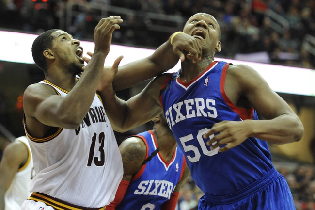 Nov 9, 2013; Cleveland, OH, USA; Cleveland Cavaliers power forward Tristan Thompson (13) and Philadelphia 76ers power forward Lavoy Allen (50) battle for a rebound in the fourth quarter at Quicken Loans Arena. Mandatory Credit: David Richard-USA TODAY Sports