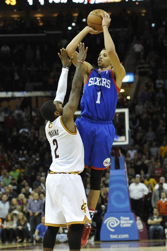 Nov 9, 2013; Cleveland, OH, USA; Philadelphia 76ers point guard Michael Carter-Williams (1) shoots over Cleveland Cavaliers point guard Kyrie Irving (2) in the second overtime at Quicken Loans Arena. Mandatory Credit: David Richard-USA TODAY Sports
