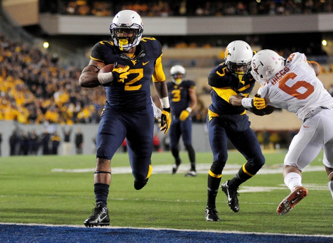 Nov 9, 2013; Morgantown, WV, USA; West Virginia Mountaineers running back Dreamius Smith (2) scores a touchdown in the fourth quarter against the Texas Longhorns at Milan Puskar Stadium. Mandatory Credit: Evan Habeeb-USA TODAY Sports