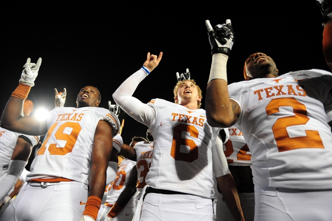 Nov 9, 2013; Morgantown, WV, USA; Texas Longhorns quarterback Case McCoy (6) celebrates with teammates after beating the West Virginia Mountaineers 47-40 in overtime at Milan Puskar Stadium. Mandatory Credit: Evan Habeeb-USA TODAY Sports