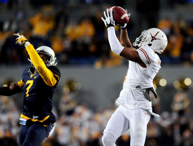 Nov 9, 2013; Morgantown, WV, USA; Texas Longhorns wide receiver Mike Davis (1) catches a pass over West Virginia Mountaineers cornerback Daryl Worley (7) at Milan Puskar Stadium. Mandatory Credit: Evan Habeeb-USA TODAY Sports
