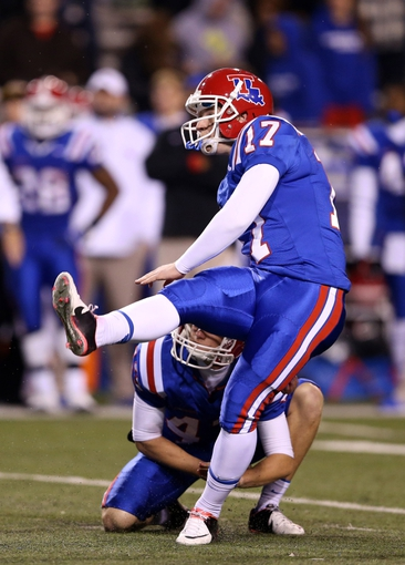 Nov 9, 2013; Ruston, LA, USA; Louisiana Tech Bulldogs kicker Kyle Fischer (17) watches one of his two second half field goals against the Southern Miss Golden Eagles at Joe Aillet Stadium. Mandatory Credit: Chuck Cook-USA TODAY Sports