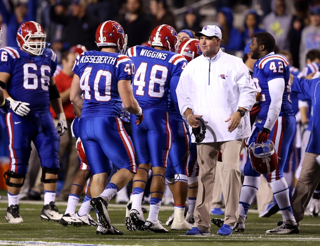 Nov 9, 2013; Ruston, LA, USA; Louisiana Tech Bulldogs head coach Skip Holtz talks to defensive end Kevin Kisseberth (40) during the second half of their game against the Southern Miss Golden Eagles at Joe Aillet Stadium. Mandatory Credit: Chuck Cook-USA TODAY Sports