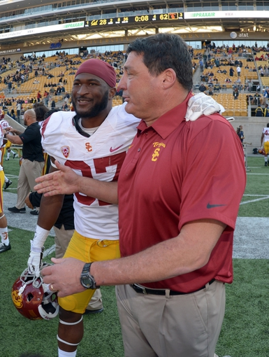 Nov 9, 2013; Berkeley, CA, USA; Southern California Trojans coach Ed Orgeron (right) and tailback Javorius Allen (37) celebrate at the end of the game against the California Golden Bears at Memorial Stadium. USC defeated California 62-28. Mandatory Credit: Kirby Lee-USA TODAY Sports