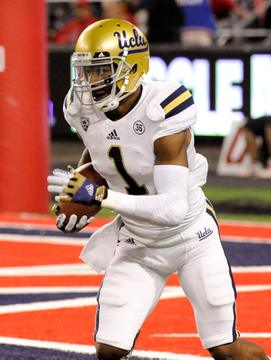 Nov 9, 2013; Tucson, AZ, USA; UCLA Bruins wide receiver Shaquelle Evans (1) runs the ball during the second quarter against the Arizona Wildcats at Arizona Stadium. Mandatory Credit: Casey Sapio-USA TODAY Sports