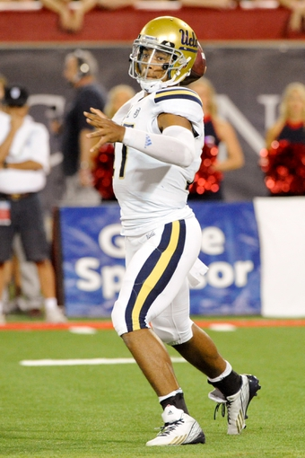 Nov 9, 2013; Tucson, AZ, USA; UCLA Bruins quarterback Brett Hundley (17) throws a pass during the second quarter against the Arizona Wildcats at Arizona Stadium. Mandatory Credit: Casey Sapio-USA TODAY Sports