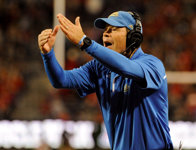 Nov 9, 2013; Tucson, AZ, USA; UCLA Bruins head coach Jim Mora calls a time out during the second quarter against the Arizona Wildcats at Arizona Stadium. Mandatory Credit: Casey Sapio-USA TODAY Sports