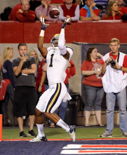 Nov 9, 2013; Tucson, AZ, USA; UCLA Bruins wide receiver Shaquelle Evans (1) catches a touchdown pass during the second quarter against the Arizona Wildcats at Arizona Stadium. Mandatory Credit: Casey Sapio-USA TODAY Sports