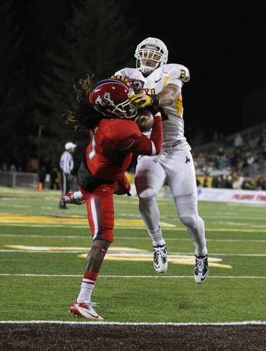 Nov 9, 2013; Laramie, WY, USA; Fresno State Bulldogs wide receiver Isaiah Burse (1) scores a touchdown against Wyoming Cowboys linebacker Mark Nzeocha (21) during the second quarter at War Memorial Stadium. Mandatory Credit: Troy Babbitt-USA TODAY Sports