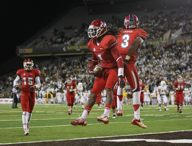 Nov 9, 2013; Laramie, WY, USA; Fresno State Bulldogs wide receiver Isaiah Burse (1) celebrates a touchdown with teammate Josh Harper (3) against the Wyoming Cowboys during the second quarter at War Memorial Stadium. Mandatory Credit: Troy Babbitt-USA TODAY Sports