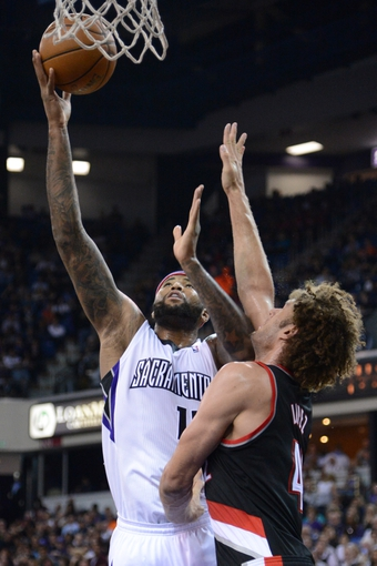 November 9, 2013; Sacramento, CA, USA; Sacramento Kings center DeMarcus Cousins (15) shoots the basketball against Portland Trail Blazers center Robin Lopez (42) during the third quarter at Sleep Train Arena. The Trail Blazers defeated the Kings 96-85. Mandatory Credit: Kyle Terada-USA TODAY Sports