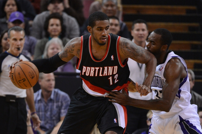 November 9, 2013; Sacramento, CA, USA; Portland Trail Blazers power forward LaMarcus Aldridge (12) dribbles the basketball against Sacramento Kings power forward Luc Richard Mbah a Moute (33) during the third quarter at Sleep Train Arena. The Trail Blazers defeated the Kings 96-85. Mandatory Credit: Kyle Terada-USA TODAY Sports