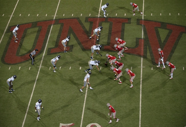 Nov 9, 2013; Las Vegas, NV, USA; The UNLV Rebels offense faces off against the visiting Utah State Aggies defense near midfield during the third quarter of an NCAA football game at Sam Boyd Stadium. Utah State won the game 28-24. Mandatory Credit: Stephen R. Sylvanie-USA TODAY Sports