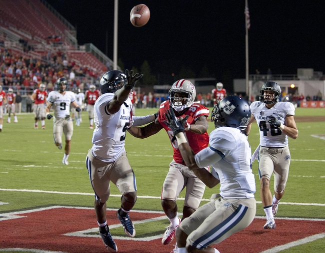 Nov 9, 2013; Las Vegas, NV, USA; Utah State Aggies cornerback Quinton Byrd (3) breaks up a pass intended for UNLV Rebels receiver Devante Davis (81) in the fourth quarter of an NCAA football game at Sam Boyd Stadium.  Utah State won the game 28-24. Mandatory Credit: Stephen R. Sylvanie-USA TODAY Sports