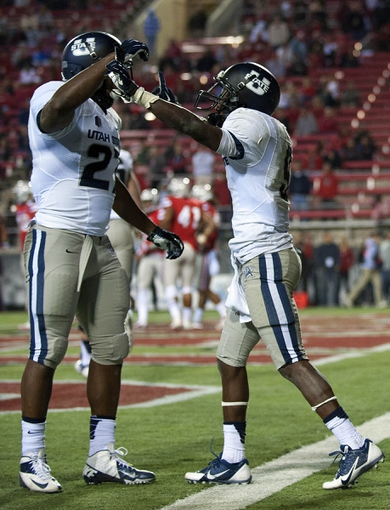 Nov 9, 2013; Las Vegas, NV, USA; Utah State Aggies wide receiver Bruce Natson (9) celebrates with Aggies running back Robert Marshall (27) after Natson scored a touchdown against the UNLV Rebels during an NCAA football game at Sam Boyd Stadium. Utah State won the game 28-24. Mandatory Credit: Stephen R. Sylvanie-USA TODAY Sports