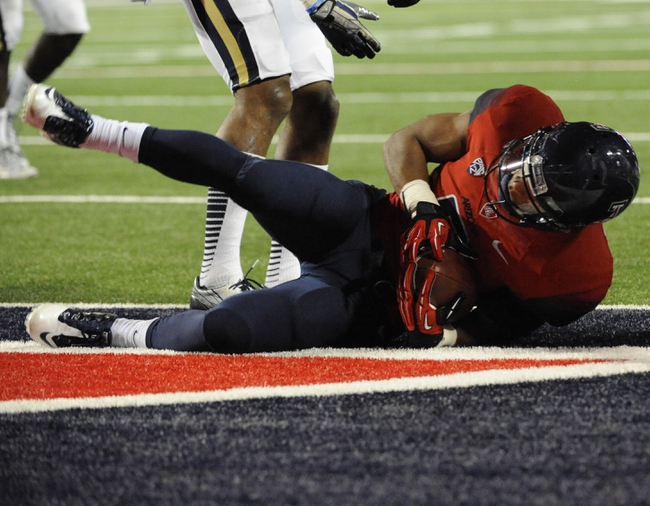 Nov 9, 2013; Tucson, AZ, USA; Arizona Wildcats receiver Nate Phillips (6) scores a touchdown against the UCLA Bruins during the fourth quarter at Arizona Stadium. UCLA beat Arizona 31-26. Mandatory Credit: Casey Sapio-USA TODAY Sports