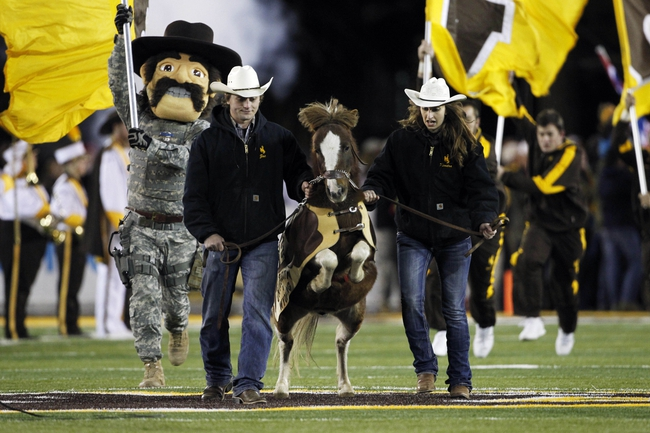 Nov 9, 2013; Laramie, WY, USA; Wyoming Cowboys live mascot Cowboy Joe on the field before the game with the Fresno State Bulldogs at War Memorial Stadium. The Bulldogs defeated the Cowboys 48-10. Mandatory Credit: Troy Babbitt-USA TODAY Sports