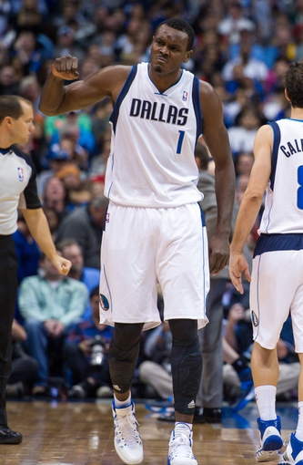 Nov 2, 2013; Dallas, TX, USA; Dallas Mavericks center Samuel Dalembert (1) celebrates a basket against the Memphis Grizzlies during the game at the American Airlines Center. The Mavericks defeated the Grizzlies 111-99. Mandatory Credit: Jerome Miron-USA TODAY Sports