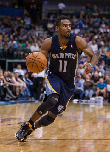 Nov 2, 2013; Dallas, TX, USA; Memphis Grizzlies point guard Mike Conley (11) drives to the basket against the Dallas Mavericks during the game at the American Airlines Center. The Mavericks defeated the Grizzlies 111-99. Mandatory Credit: Jerome Miron-USA TODAY Sports