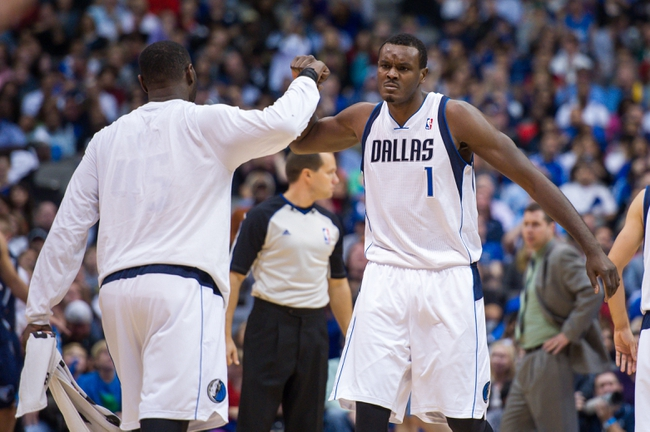 Nov 2, 2013; Dallas, TX, USA; Dallas Mavericks center Samuel Dalembert (1) and center DeJuan Blair (45) celebrate a basket against the Memphis Grizzlies during the game at the American Airlines Center. The Mavericks defeated the Grizzlies 111-99. Mandatory Credit: Jerome Miron-USA TODAY Sports