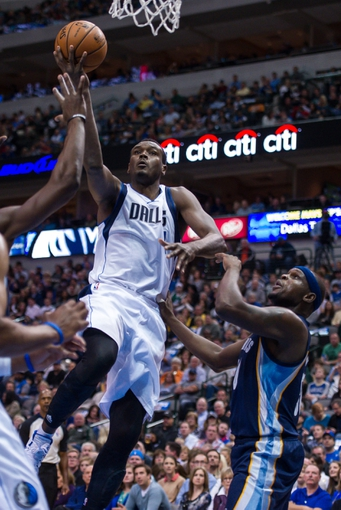Nov 2, 2013; Dallas, TX, USA; Dallas Mavericks center Samuel Dalembert (1) drives to the basket past Memphis Grizzlies power forward Zach Randolph (50) during the game at the American Airlines Center. The Mavericks defeated the Grizzlies 111-99. Mandatory Credit: Jerome Miron-USA TODAY Sports