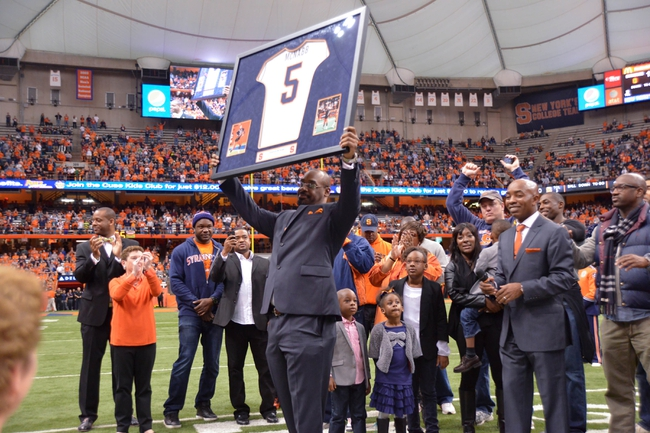 Nov 2, 2013; Syracuse, NY, USA; Syracuse Orange former quarterback Donovan McNabb has his jersey retired during halftime of a game against the Wake Forest Demon Deacons at the Carrier Dome. Mandatory Credit: Mark Konezny-USA TODAY Sports