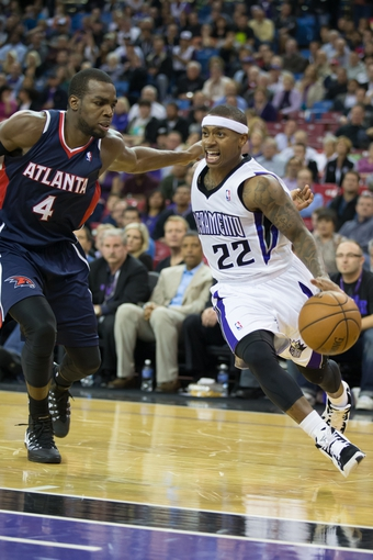 Nov 5, 2013; Sacramento, CA, USA; Sacramento Kings point guard Isaiah Thomas (22) drives in against Atlanta Hawks power forward Paul Millsap (4) during the fourth quarter at Sleep Train Arena. The Atlanta Hawks defeated the Sacramento Kings 105-100. Mandatory Credit: Kelley L Cox-USA TODAY Sports