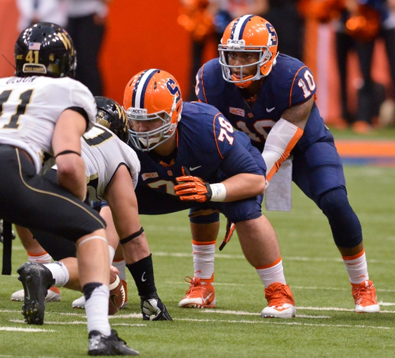 Nov 2, 2013; Syracuse, NY, USA; Syracuse Orange quarterback Terrel Hunt (10) under center Jason Emerich (78) during the fourth quarter of a game against the Wake Forest Demon Deacons at the Carrier Dome. Syracuse won the game 13-0. Mandatory Credit: Mark Konezny-USA TODAY Sports