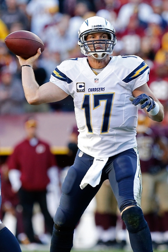 Nov 3, 2013; Landover, MD, USA; San Diego Chargers quarterback Philip Rivers (17) prepares to throw the ball against the Washington Redskins at FedEx Field. Mandatory Credit: Geoff Burke-USA TODAY Sports