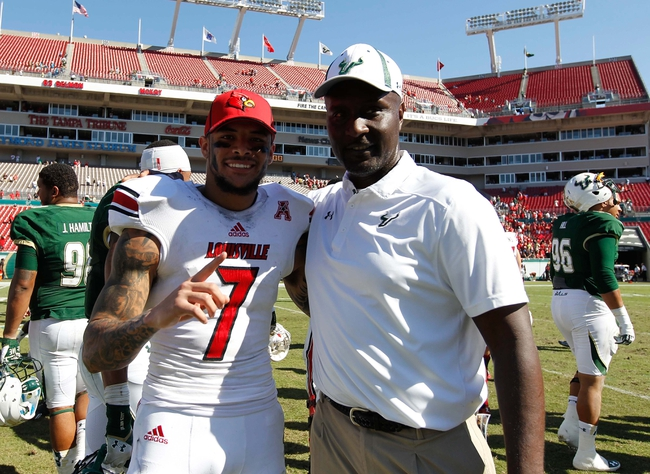 Oct 26, 2013; Tampa, FL, USA; Louisville Cardinals wide receiver Damian Copeland (7) and South Florida Bulls assistant coach Raymond Woodie  after the game at Raymond James Stadium. Mandatory Credit: Kim Klement-USA TODAY Sports