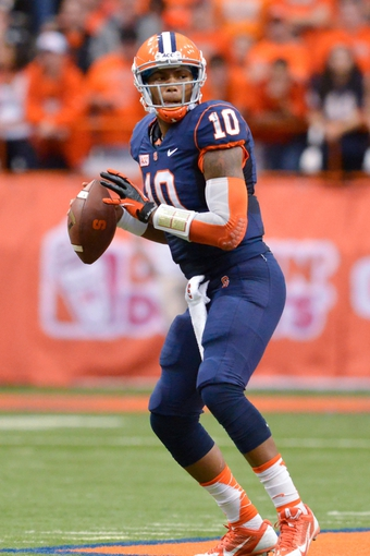 Nov 2, 2013; Syracuse, NY, USA; Syracuse Orange quarterback Terrel Hunt (10) drops back to pass during the second quarter of a game against the Wake Forest Demon Deacons at the Carrier Dome. Mandatory Credit: Syracuse won the game 13-0. Mark Konezny-USA TODAY Sports