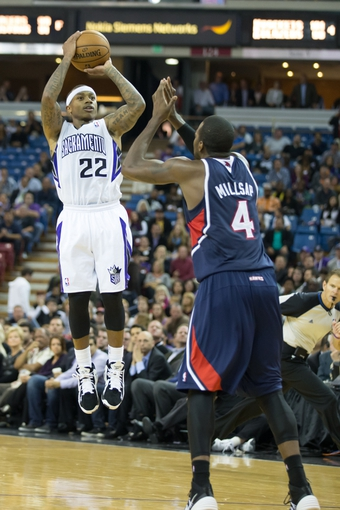 Nov 5, 2013; Sacramento, CA, USA; Sacramento Kings point guard Isaiah Thomas (22) shoots the ball against Atlanta Hawks power forward Paul Millsap (4) during the fourth quarter at Sleep Train Arena. The Atlanta Hawks defeated the Sacramento Kings 105-100. Mandatory Credit: Kelley L Cox-USA TODAY Sports