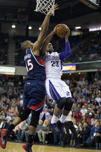 Nov 5, 2013; Sacramento, CA, USA; Sacramento Kings shooting guard Marcus Thornton (23) goes up for basket against Atlanta Hawks center Al Horford (15) during the fourth quarter at Sleep Train Arena. The Atlanta Hawks defeated the Sacramento Kings 105-100. Mandatory Credit: Kelley L Cox-USA TODAY Sports