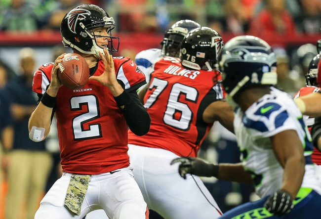 Nov 10, 2013; Atlanta, GA, USA; Atlanta Falcons quarterback Matt Ryan (2) drops back to pass in the first half against the Seattle Seahawks at the Georgia Dome. Mandatory Credit: Daniel Shirey-USA TODAY Sports