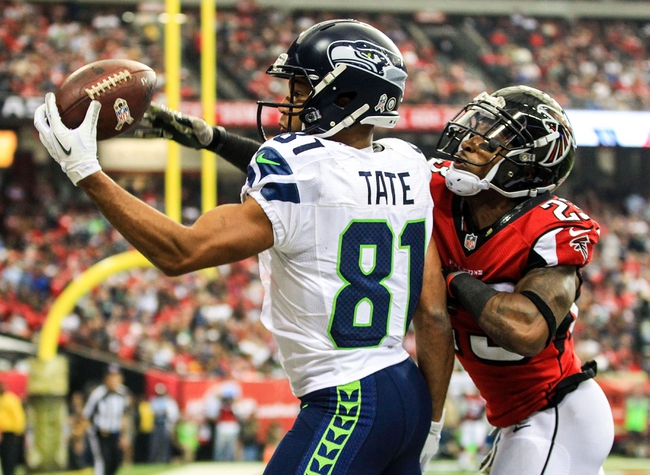 Nov 10, 2013; Atlanta, GA, USA; Seattle Seahawks wide receiver Golden Tate (81) makes a catch for a touchdown under pressure from Atlanta Falcons cornerback Robert Alford (23) in the first half at the Georgia Dome. Mandatory Credit: Daniel Shirey-USA TODAY Sports
